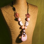 Custom, symmetrical, in soft pink, with Gold Letter Beads, and Pink Teardrop Pendant