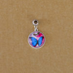 Blue butterfly on red resin pendant