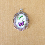 Purple butterfly & green dragonfly resin pendant